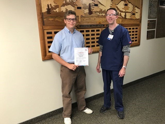 Daniel McCarthy (left) is shown here with St. Mary's/Clearwater Valley hospitals RN and CPRtest giver Jessie Shepard.  Contributed photo