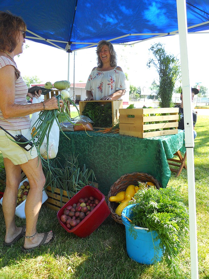 Contributed photo / Michelle Perdue Tonya Kaschmitter-Ormsby sells Camas Farms produce at the Grangeville Farmers' Market earlier this summer.