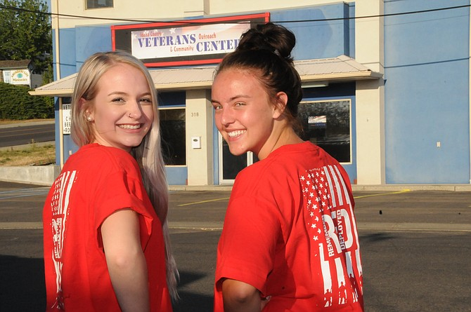(L-R) Grangeville High School seniors Morgan Crea and Tessa Godfrey wear read T-shirts to bring awareness to their R.E.D. senior project – Remember Everyone Deployed.