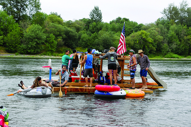 Crew members embark on the Great Willamette River Race on the Philip Rivers boat on Saturday morning.