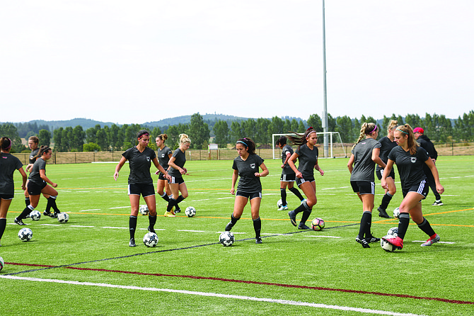 Western Oregon's soccer team practices dribbling on Monday afternoon.