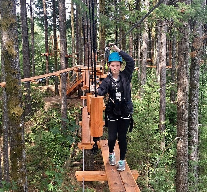 Alexis Welvaert,12, of White Salmon takes on one of the elements at Skamania Lodge's new aerial park, which opened earlier this month. The aerial park is open to the public.