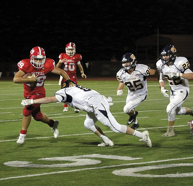 Hunter Chase eludes a Bend defender on Friday night.