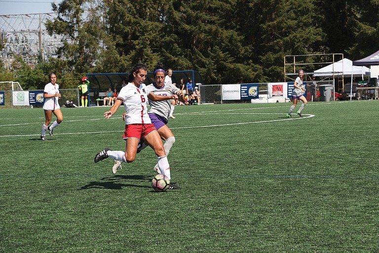 Western Oregon defender Kaitlin Poe attempts to advance the ball up the field on Saturday afternoon.