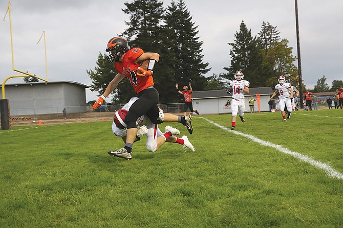 Dallas running back Brycen Grillo scores during the Dragons' 54-0 victory over North Eugene on Friday night.