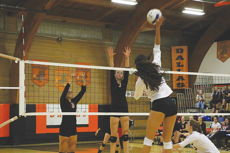 Emma Classen (5) and Tristin Savage (7) go up for a block against Crescent Valley.