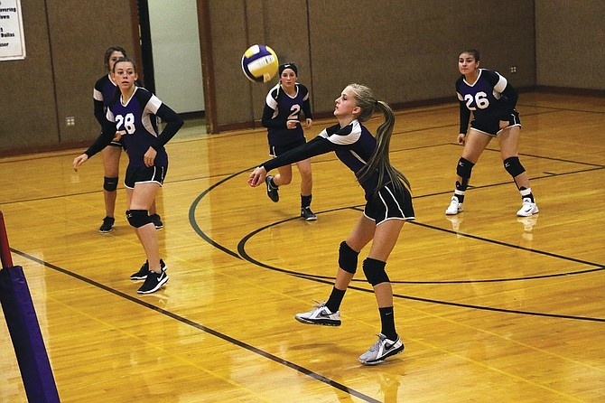 The Mountaineers return a serve during Falls City's victory over Livingstone Adventist on Sept. 6.