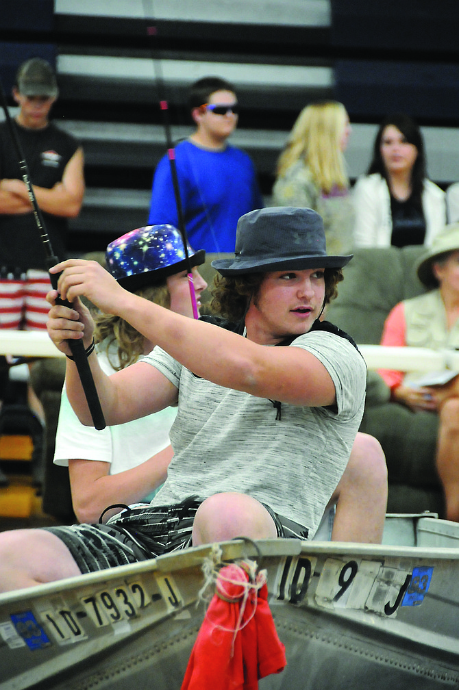 "Grangeville High School juniors (front to back) Justin Fogleman and Blake Darr were fishing away as part of the GHS homecoming skit for the ""Jaws Juniors"" on movie theme day Thursday, Sept. 14. All students participated in daily dress-up themes, class skits, cheers, games and parade."