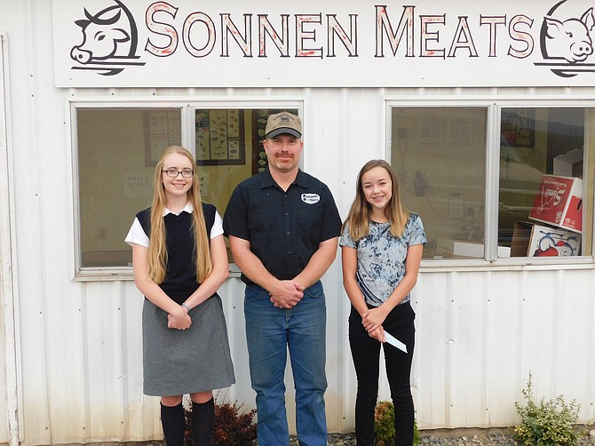 The Idaho County Carcass Show and Judging Contest was held on Wednesday, Aug. 23. Pictured are (L-R) Jessie Sonnen, Norm Sonnen (sponsor of the cash awards) and Taryn Godfrey. Not pictured: Rachael Stevens.  Contributed photo