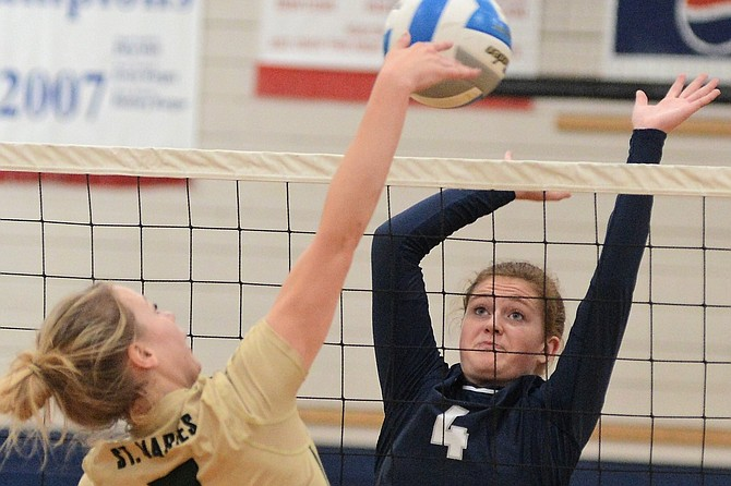 Pictured is Grangeville's Paige Lindsley blocking a hit by St. Maries middle hitter Kaci Haeg during the visiting team's 3-0 win over the Bulldogs in Central Idaho League volleyball action at GHS last Saturday, Sept. 23.