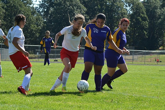 Columbia High's Lillie Goodson, center, tries to dribble around a pair of Goldendale players during last Saturday's non-league soccer match in Bruin Stadium. Alondra Cazares tallied two of CHS's three goals  in the 3-2 Bruin victory. The match was a make-up of the Sept. 16 contest that was postponed due to poor air quality here.
