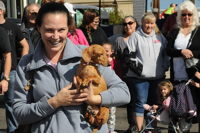 Heather Slichter of Grangeville holds her dog after it crossed the finish line in the annual Oktoberfest Winer Dog races. Results were not available as of press time Tuesday. More than 12 dogs raced as a crowd of bystanders watched the canines scramble toward their owners.
