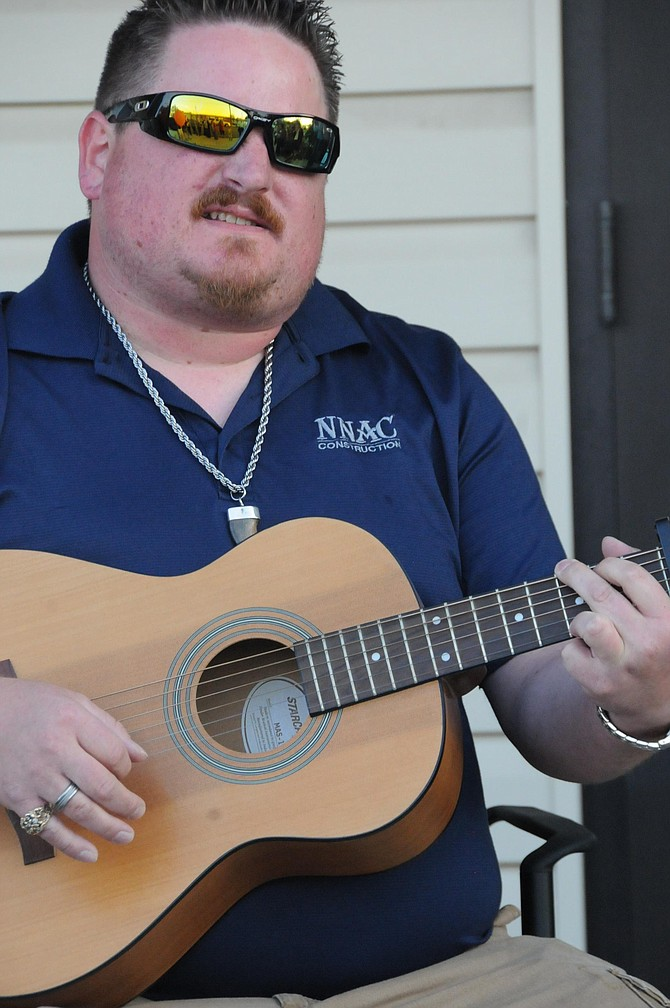 ConstructionCrooner: JasonRichards with National Native American Construction, Inc., out of Coeur d'Alene sings a song at the Syringa Hospital and Clinics Oktoberfest block party Sept. 29.