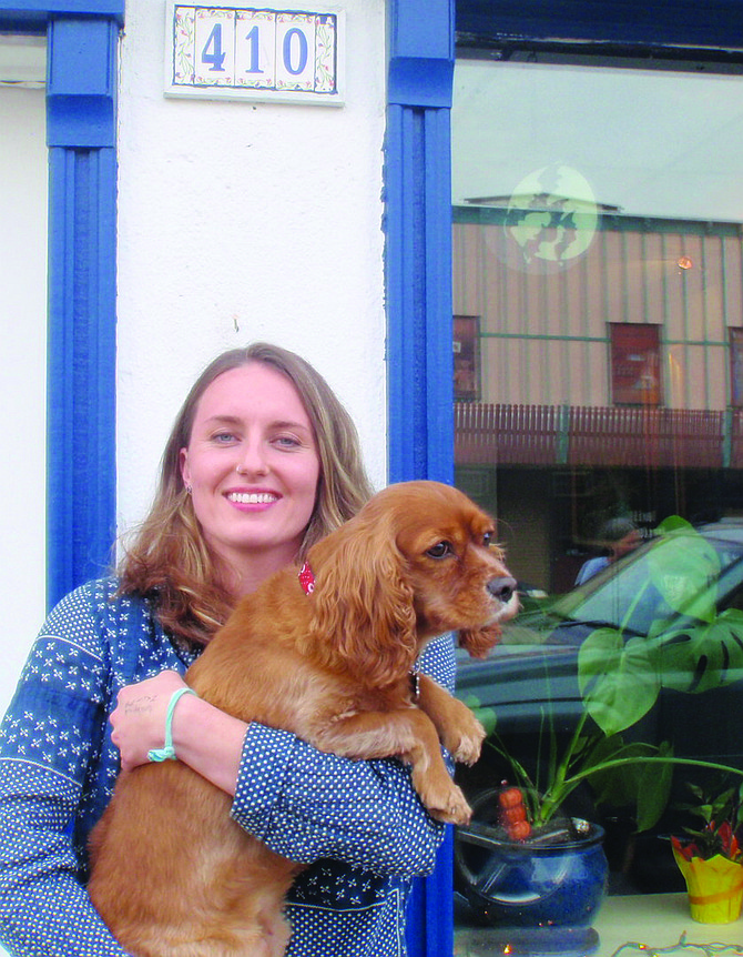 Free Press / Norma Staaf Lauren Paterson has just opened a Muse Media at 410 Main Street, Kamiah. She is pictured here with her dog, Sophie.