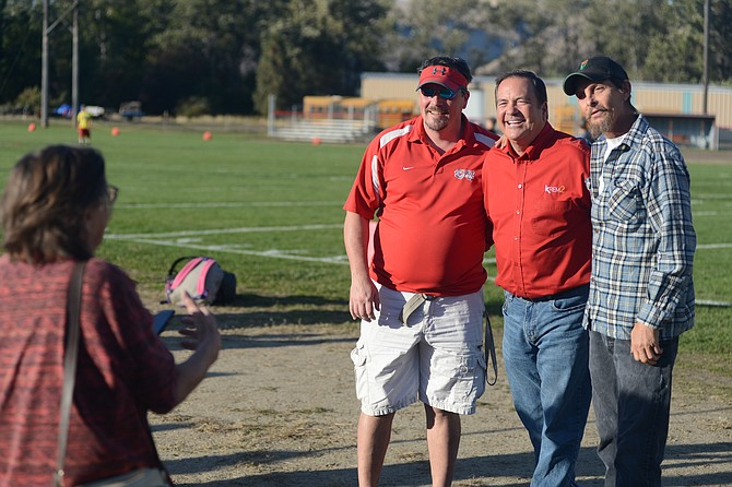 (L-R) Clearwater Valley High School athletic director Kolby Krieger is pictured here with Tom Sherry of KREM 2 News inSpokane and Bill Finnan. CVHSwas the recipient of a Tom's Tailgate pre-game party Friday, Oct. 6. About 100 people turned out for the tailgate party and KREM 2 donated $222 to Clearwater Valley schools.