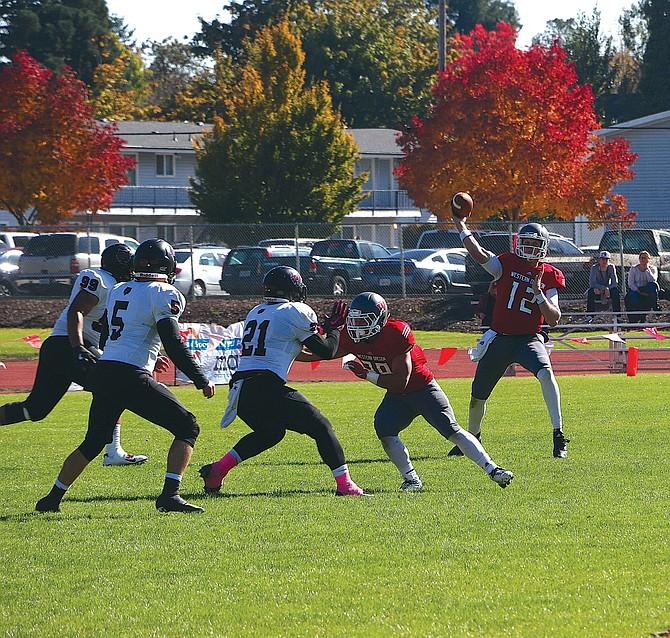 Western Oregon quarterback Nick Duckworth (12) throws a pass against Central Washington on Saturday.