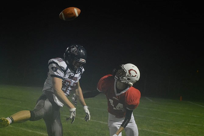 Columbia receiver William Gross, right, tracks an incoming pass from Adam Goodwillie late in the fourth quarter of last Friday's homecoming game. Gross made the catch for a 23-yard gain that helped set up the Bruins' game-tying touchdown as regulation time expired.
