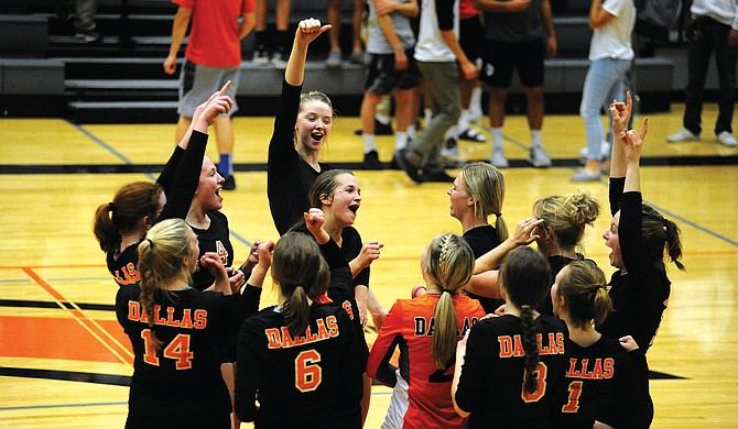 Dallas' volleyball team celebrates during its victory over Crater in the 5A state play-in round on Oct. 24.