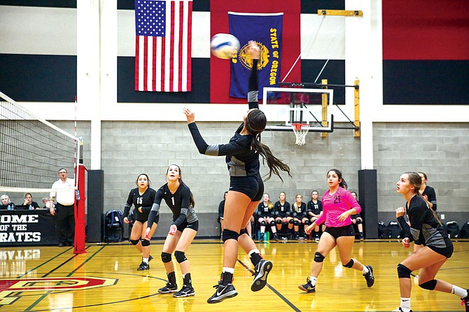 Alyssa Lux goes for a kill during the Pirates win over Damascus Christian on Oct. 25.