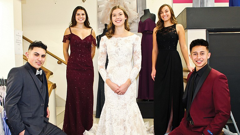 """Fashion Corner wedding party models, left to right Daniel Singleterry, Molly Marquez, Allison Davis, Brielle Newhouse, and Tyler Hunsaker, offer a sample of the wedding apparel to be on display at the """"Here We Are"""" Bridal Show set for Nov. 12."""