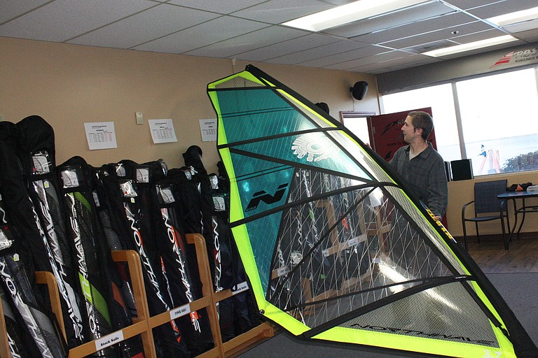 Northwave Sails employee Scott Boudreau checks out a sail made at the shop. Northwave offers custom-made wind surfing sails.
