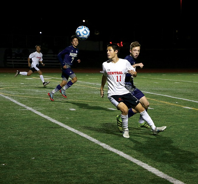 Central junior forward Brandon Lopez fights to gain possession of a loose ball against Marist Catholic on Nov. 1.