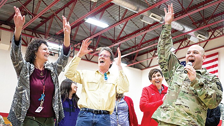 Joey Castilleja, Sunnyside resident and White Swan principal dances with other members of the National guard and friends.