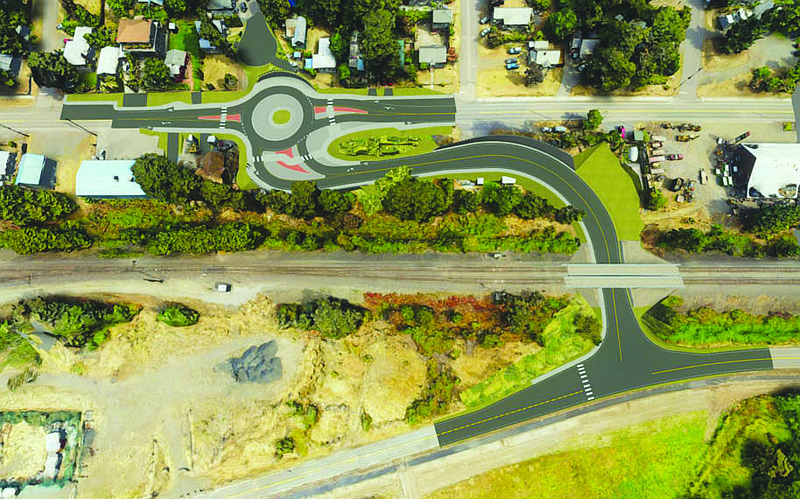 This is an update to the proposed traffic circle and Bingen Point Access. The large gray portion of the circle will have sloped curbs to allow for trucks with difficult turning radiuses to roll on to the circle and make it through without too much traffic disturbance. (WSDOT Image)