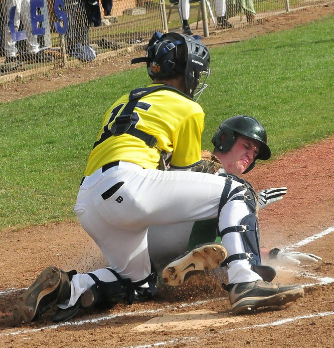 HRV Catcher Kyle Beam puts the tag on Peter Davis of Jesuit as Davis slides into home in the second inning. Davis was ruled safe on the play at the plate, but Beam put out another Jesuit runner out at the plate in the next inning with a lunging tag.