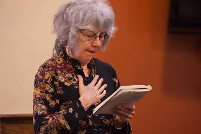Oregon Poet Laureate Paulann Petersen reads one of her poems during a visit to the Sherman County Public/School library in Moro May 4.