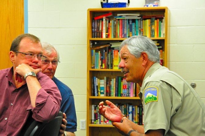 Hood River County Sherriff Joe Wampler (right) confers with Hood River County Administrator David Meriwether and Hood River County Commission Chair Ron Rivers during a mediation session on NORCOR jail funding.