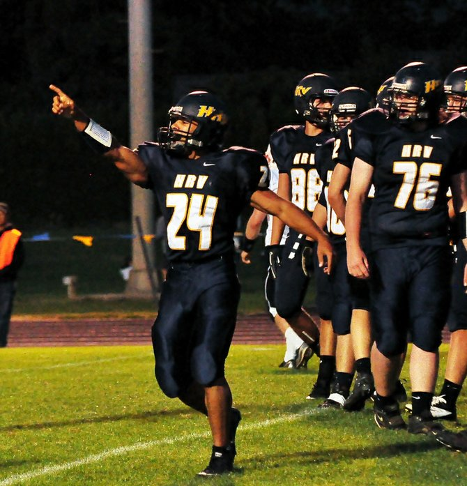 Forrest Broddie celebrates one of his three rushing touchdowns against Sandy Friday night.