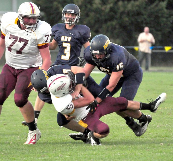 HRV football players Nick Morgan (59) and eli fults (15) bring down a Redmond ball carrier Friday night.