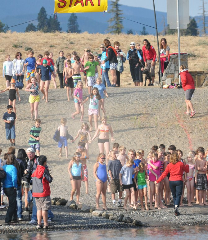 Ready, set, go: Gorge Kids Triathlon participants were released in waves for the swimming leg of Sunday&#39;s event. Hundreds of kids (and parents) turned out to the Hood River Waterfront Park for the event, which served as a fundraiser for elementary school health and athletic programs.