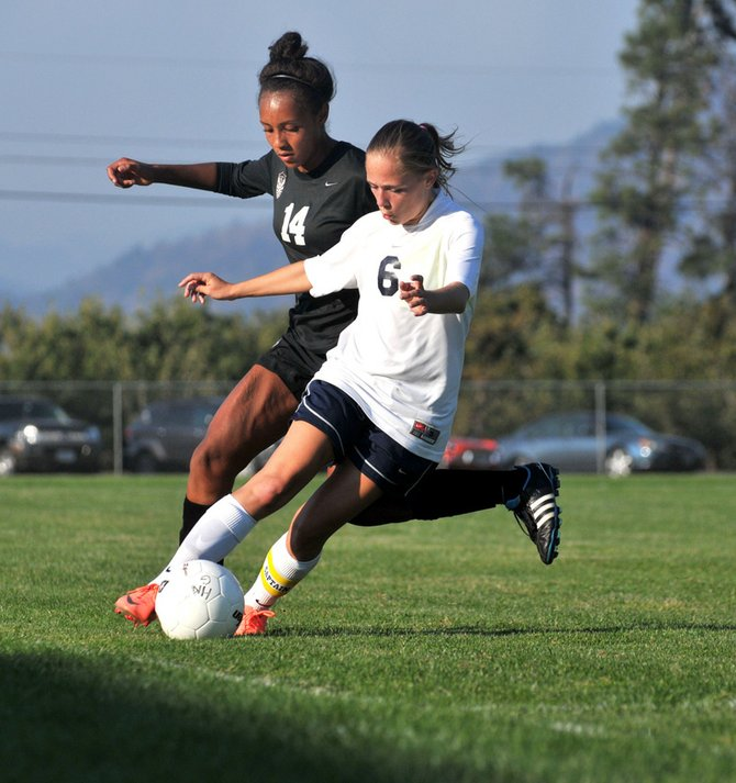 Kristin Lago battles against Tualatin's Ariana Pumpelly (14)  during HRV's  5-0 loss against the Timberwolves.