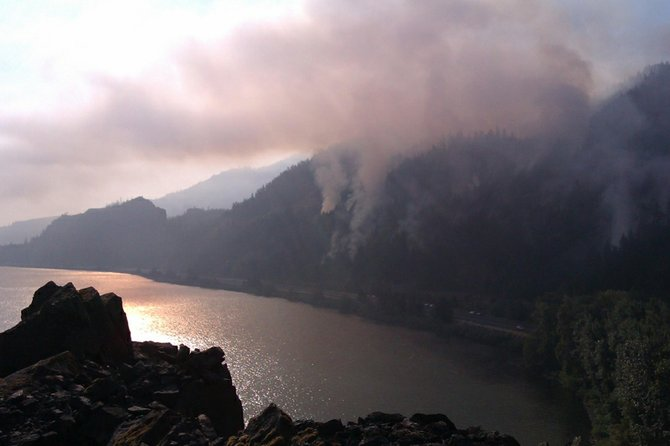 Crews are battling a growing wildfire between Hood River and Mosier.