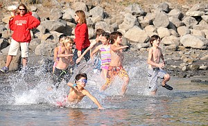 Participants splash into the water at Hood River waterfront park during the Gorge Kids Triathlon.