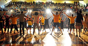 Photo of the day, September 28, 2012: Hood River Valley High School staff members take a round of applause Thursday during the annual Air Guitar contest. The annual Homecoming staple has become one of the biggest events of the year for the school. This year the senior class edged out the staff by eight points, followed by the juniors in third, sophomores in fourth and the freshman in last.