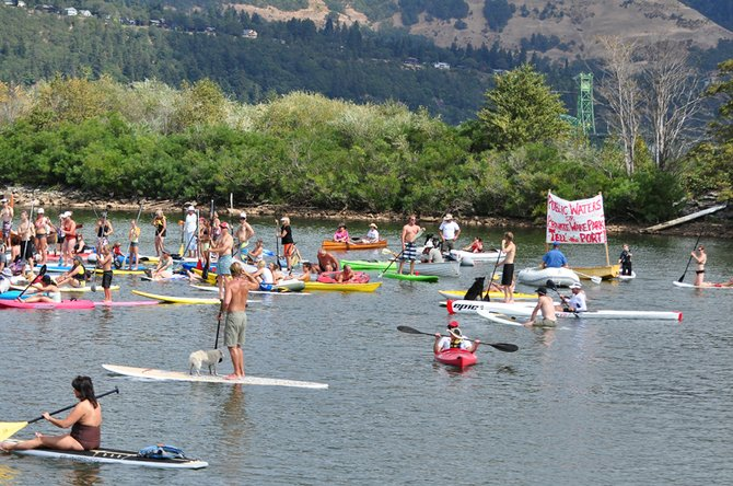 "Protesters stage a ""float-in"" against a proposed wakeboarding cable park in the Nichols basin in September of 2012."