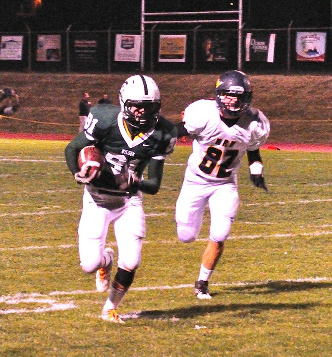 Wilson reciever Josh Hagge sprints away from an HRV defender in the second half of Wilson's 41-16 win over the Eagles, October 5, 2012.