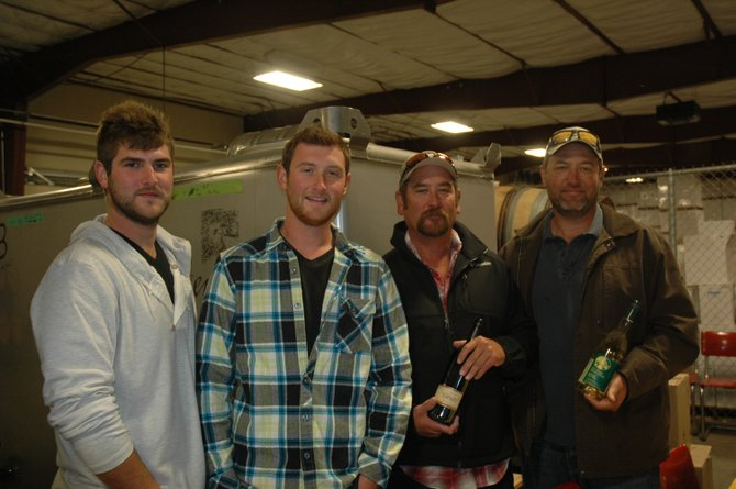 A new set of Kennedy's are about to take over the White House - Hood River style. From left to right, Andy, Jack, Pat and Barry Kennedy of Odell are taking the reins of the Gorge White House beginning Nov. 1. Seen here on a recent visit and tour of Steve and Don Bickford's Mt. Hood Winery operations, the family is stepping in as Camille Hukari and Jerry Tausend look forward to retirement.