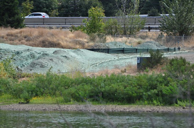 Dirt piles mark the site of a proposed hotel and commercial building project at the south end of Nichols basin on the Hood River waterfront.
