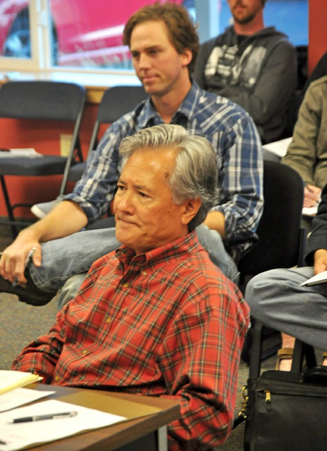 Developer Bob Naito talks to the Hood River Port Commission October 16, 2012 while Friends of the Hood River Waterfront Attorney Brent Foster (in background) waits for his chance to speak.