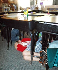 MAY STREET kindergartners 'duck and cover' in an earthquake drill, that was one of several safety lessons and exercises Thursday.