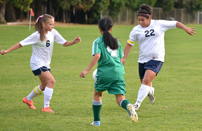Christina Silva (22) in the process of scoring the winning goal in Thursday's game.