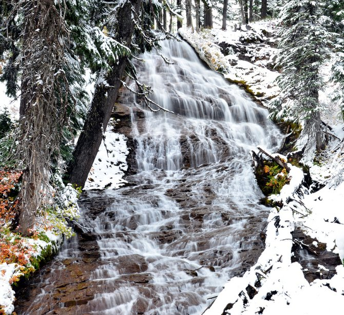 Umbrella Falls cascades through a fresh blanket of snow on the side of Mount Hood. The waterfall isn&#39;t far from Mt. Hood Meadows Ski Area, which is reporting more than a foot of snow at its base area. A boots-on-the-ground test Sunday afternoon verified that measurement.