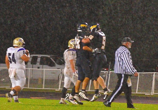 Connor Normand (28) Dylan Jones (58) celebrate a stop by the HRV defense against Hermiston, October 19, 2012.