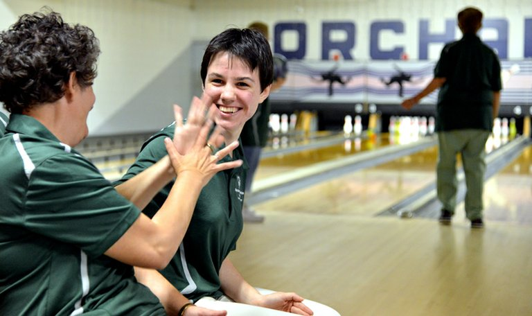 <aroaj L:ander and Ester Simmons at Special Olympics bowling practice at Orchard Lanes.