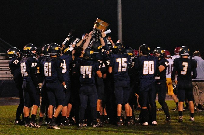 HRV football players celebrate with the Old Water Bucket Trophy after beating The Dalles-Wahtonka 43-0, October 26, 2012.