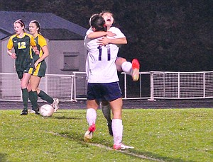 Kara Kiyokawa gets a hug from Collette Zack after Kiyokawa scored the second of her two goals against Cleveland, November 1, 2012.